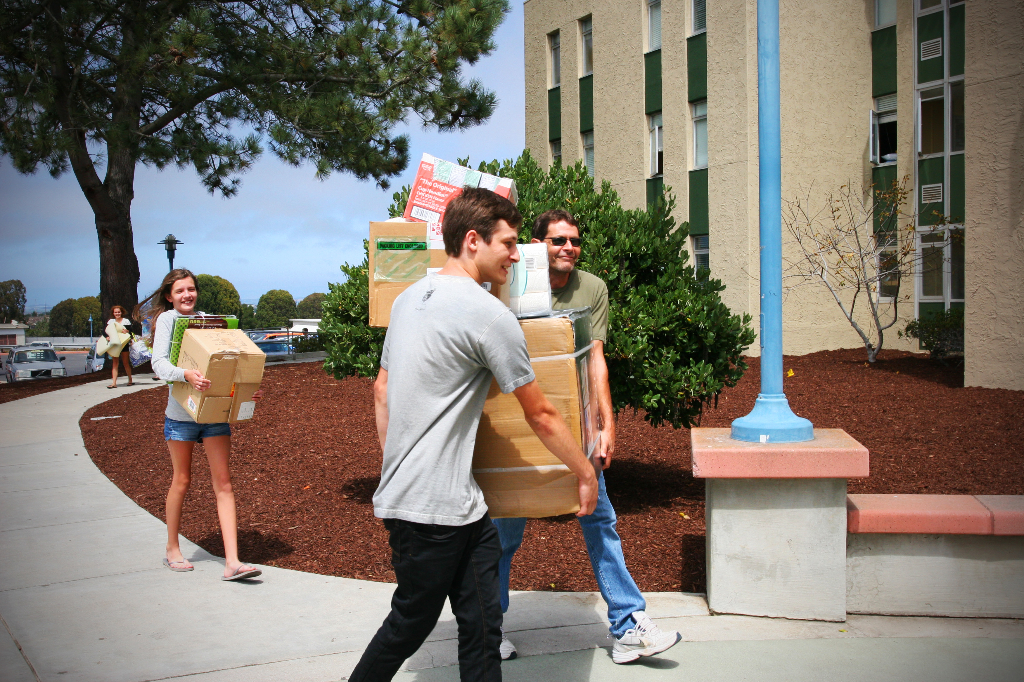 Students Moving In carrying boxes