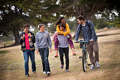 Five students walking on campus