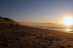 students walking on beach