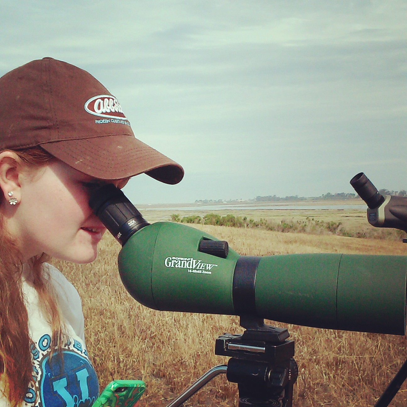 student looking through sighting scope
