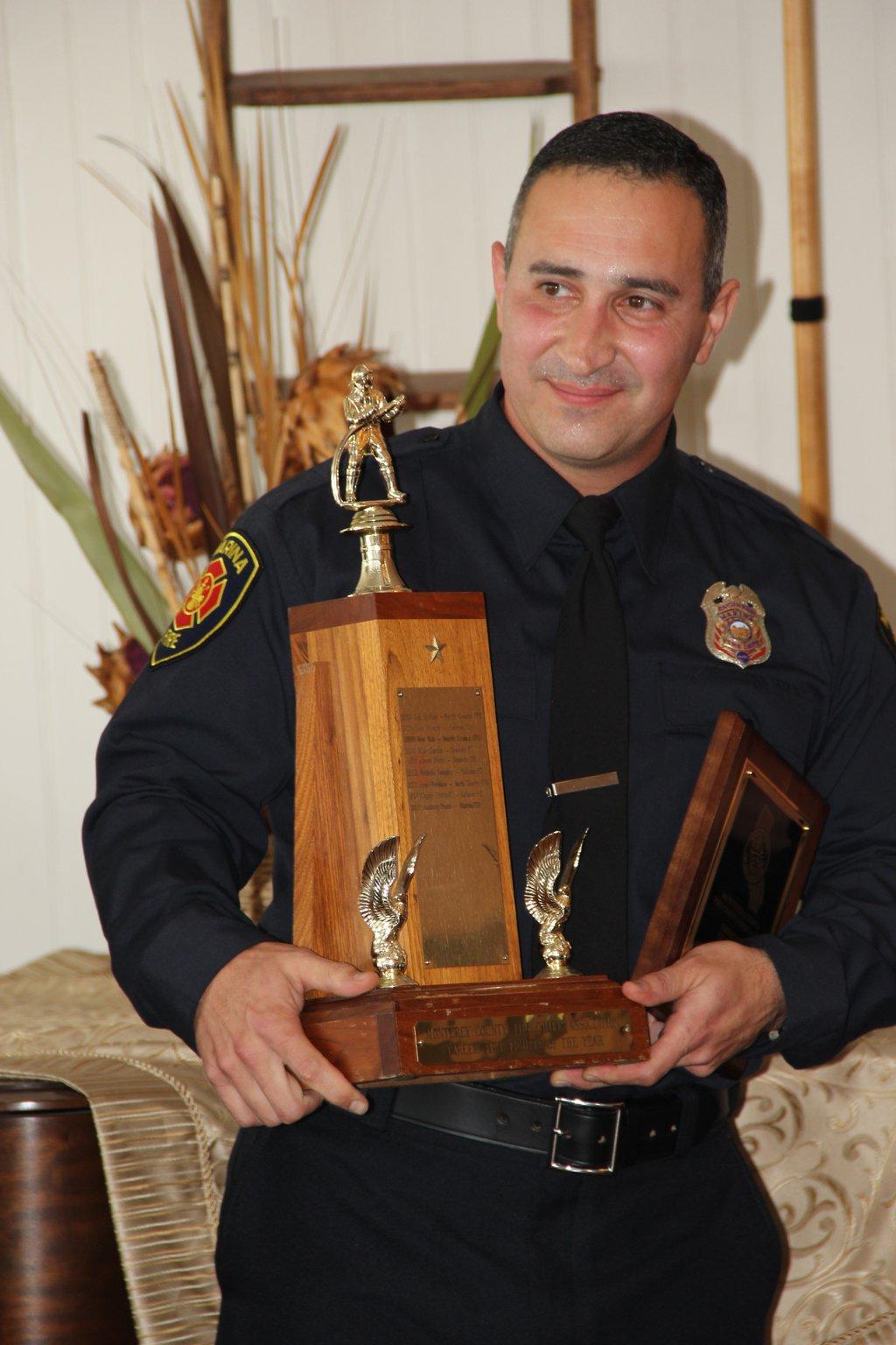 Anthony Prado with award