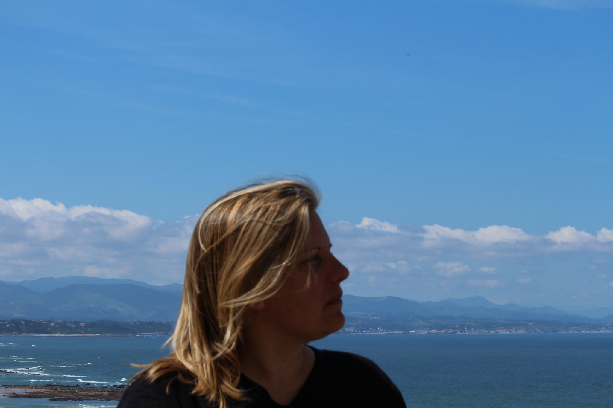 profile of head against background of ocean bay