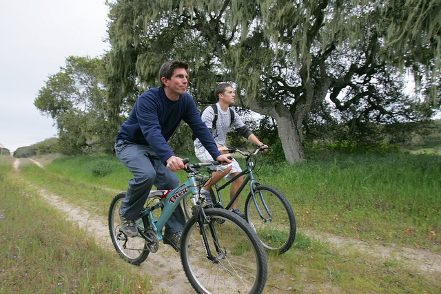 Students biking on a on-campus trail