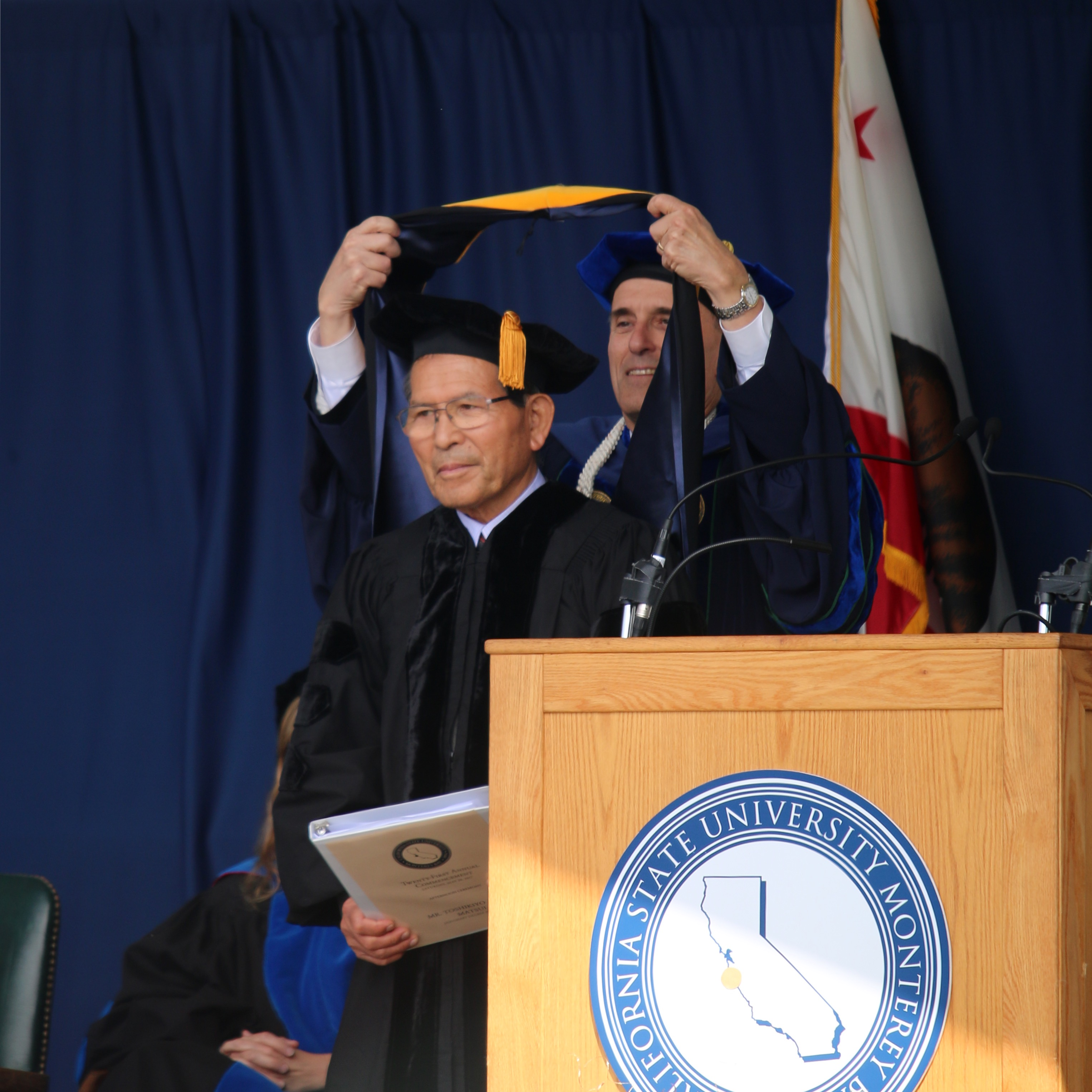Andy Matsui is awarded an honorary Doctorate of Science.