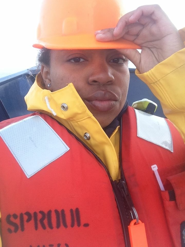REU student profile picture. Student in life jacket and helmet.
