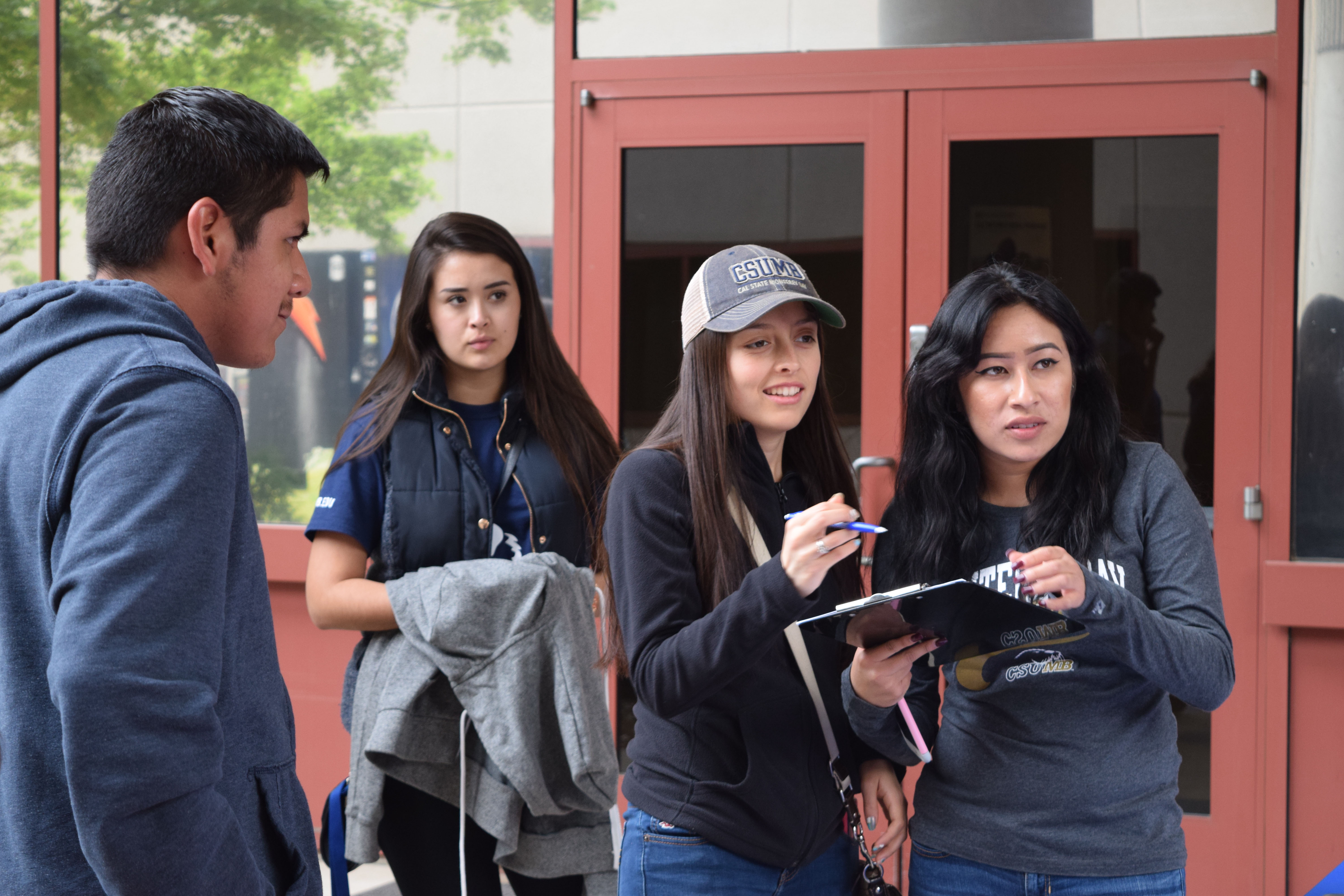 Students holding clipboard