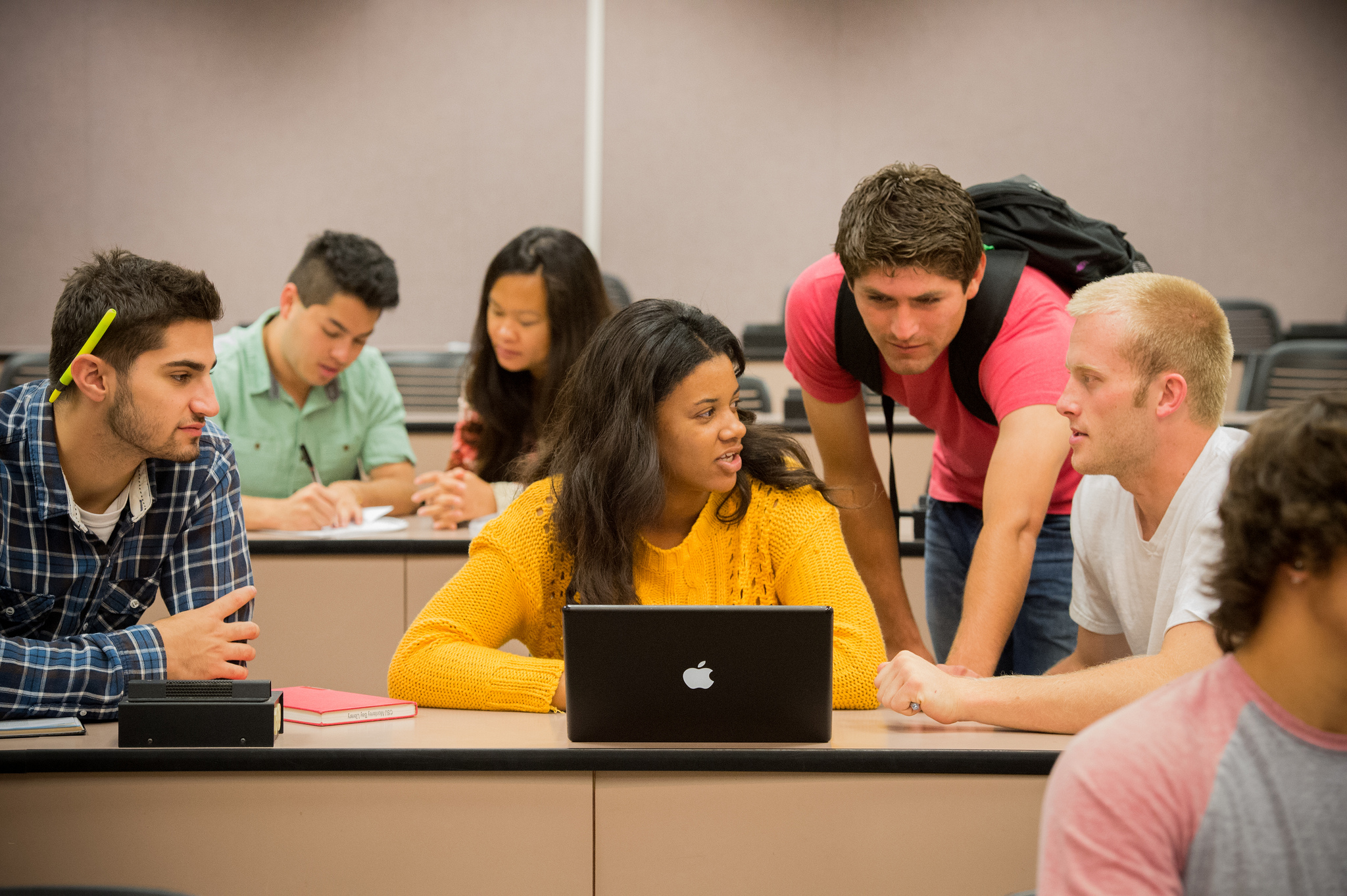 Enrollment -  of CSUMB students collaborating in classroom.