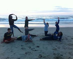 Students spelling out REU on the beach