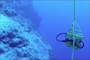 Battery box underwater near reef